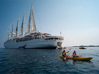 Kayaking with Sailing Ship in background