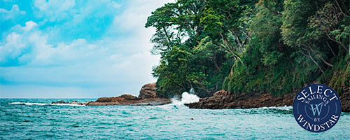 Costa Rican coastline with trees and rocks